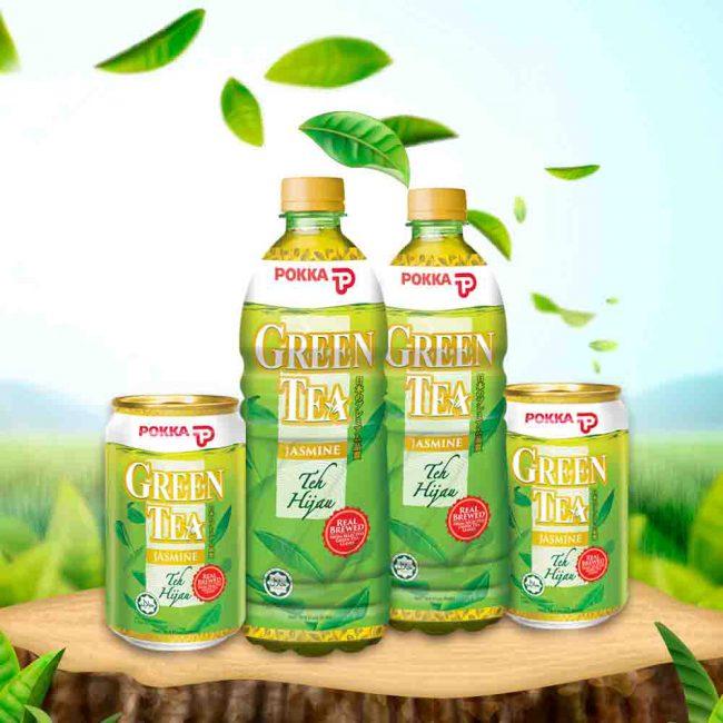 Range of POKKA Green Tea on top of tree with greenery background